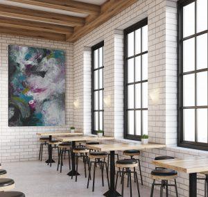 Grande toile sur mur en brique blanc
